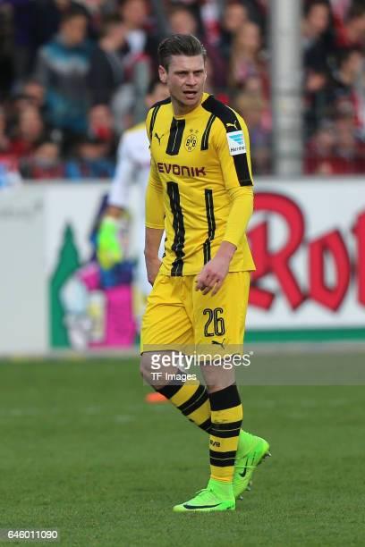 Lukasz Piszczek of Dortmund looks on during the Bundesliga match between Sport Club Freiburg and Borussia Dortmund at SchwarzwaldStadion on February...