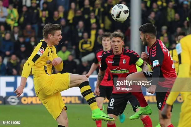 Lukasz Piszczek of Dortmund Marc Torrejon of Freiburg battle for the ball during the Bundesliga match between Sport Club Freiburg and Borussia...