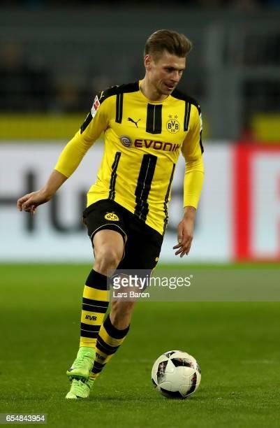 Lukasz Piszczek of Dortmund runs with the ball during the Bundesliga match between Borussia Dortmund and FC Ingolstadt 04 at Signal Iduna Park on...