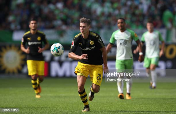 Lukasz Piszczek of Dortmund runs with the ball during the Bundesliga match between VfL Wolfsburg and Borussia Dortmund at Volkswagen Arena on August...