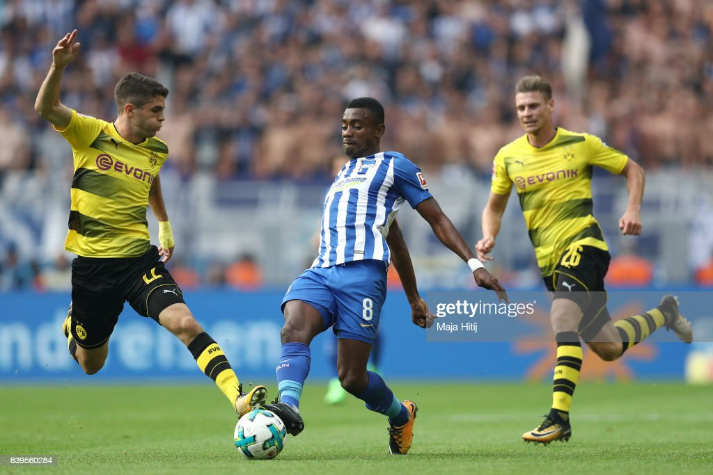 Lukasz Piszczek of Dortmund (l), Salomon Kalou of Berlin (c) and Lukasz Piszczek of Dortmund during the Bundesliga match between Borussia Dortmund and Hertha BSC at Signal Iduna Park on August 26, 2017 in Dortmund, Germany.