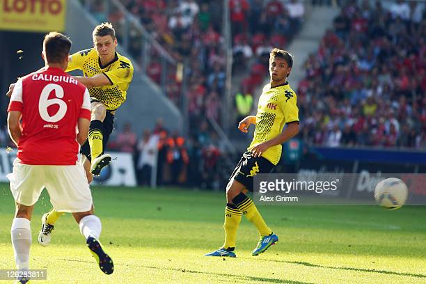 Lukasz Piszczek of Dortmund scores his team's second goal during the Bundesliga match between FSV Mainz 05 and Borussia Dortmund at Coface Arena on...