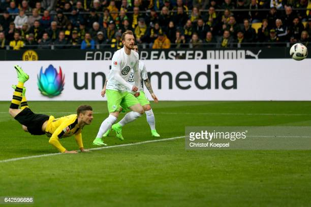 Lukasz Piszczek of Dortmund scores the second goal during the Bundesliga match between Borussia Dortmund and VfL Wolfsburg at Signal Iduna Park on...