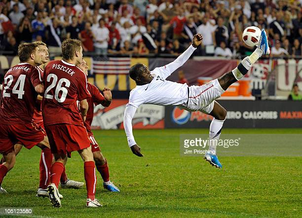 Lukasz Piszczek of Poland defends as Jozy Altidore of the USA attempts a bicycle kick on goal during the second half of their match on October 9 2010...