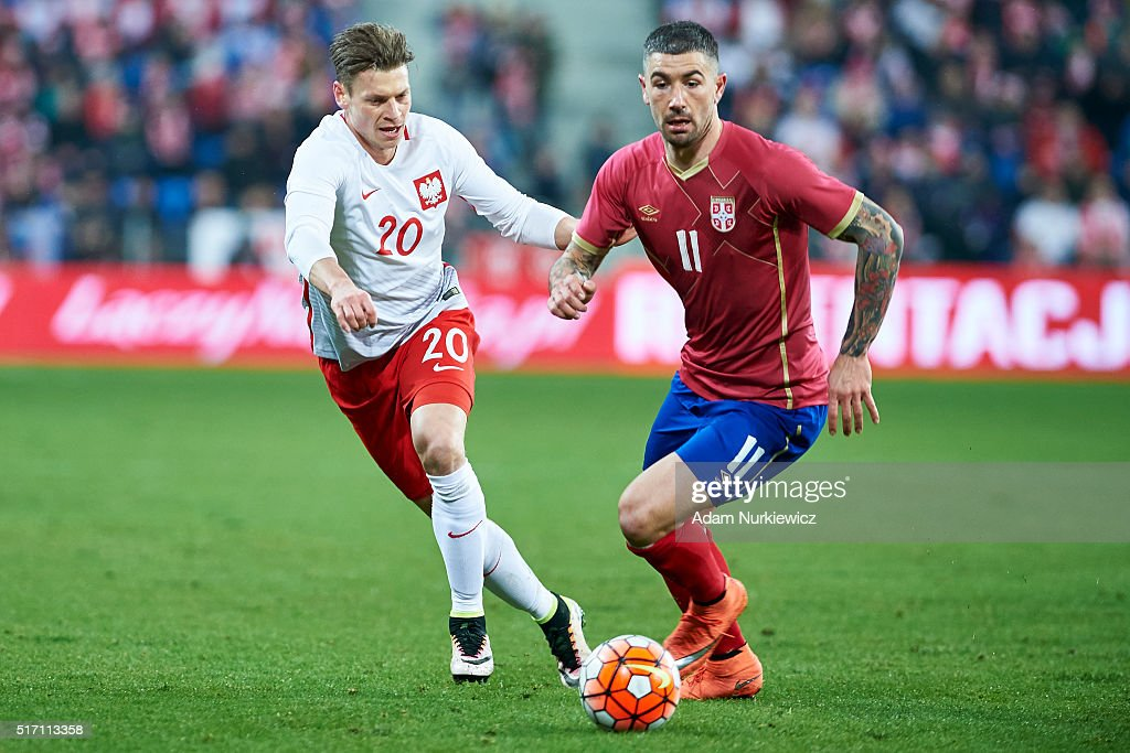 Lukasz Piszczek of Poland fights for the ball with Aleksandar Kolarov of Serbia during the international friendly soccer match between Poland and...