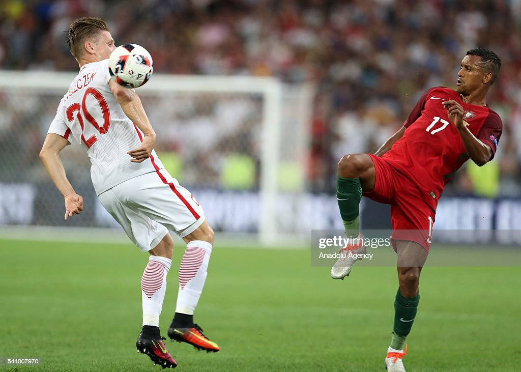 Lukasz Piszczek (L) of Poland in action against Nani (R) of Portugal during the Euro 2016 quarter-final football match between Poland and Portugal at the Stade Velodrome in Marseille, France on June 30, 2016.