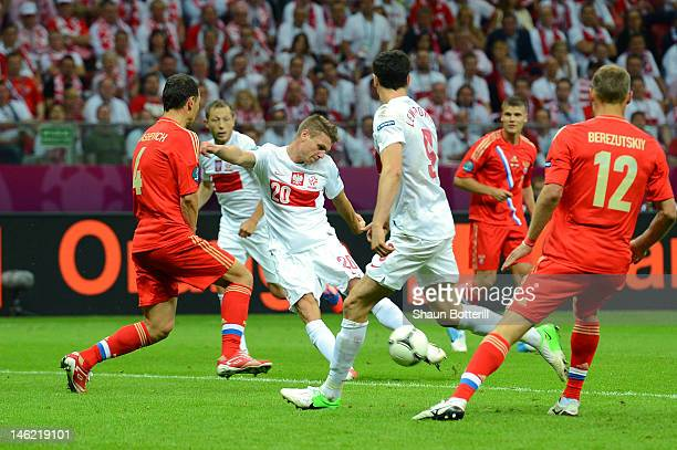 Lukasz Piszczek of Poland shoots on goal during the UEFA EURO 2012 group A match between Poland and Russia at The National Stadium on June 12 2012 in...