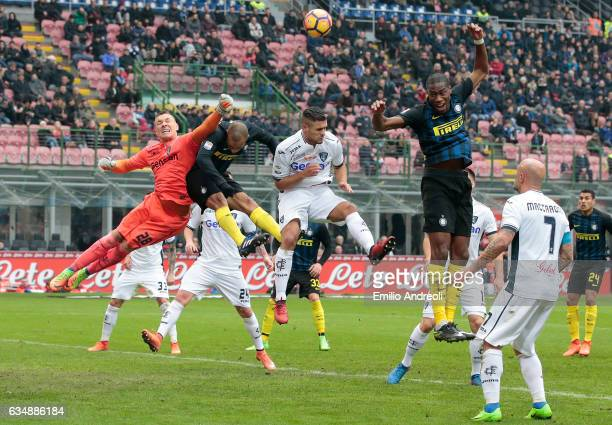 Lukasz Skorupski of Empoli FC jumps for the ball with Joao Miranda of FC Internazionale Milano during the Serie A match between FC Internazionale and...