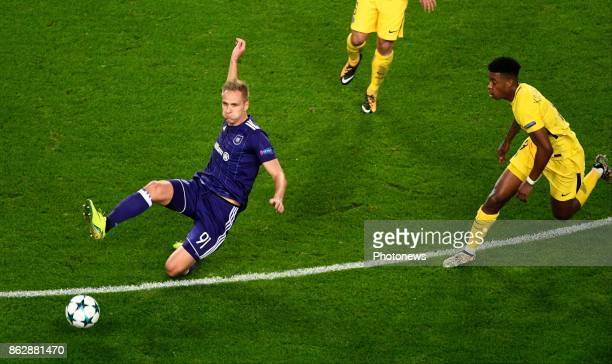 Lukasz Teodorczyk forward of RSC Anderlecht and Fresnel Kimpembe defender of PSG during the Champions League Group B match between RSC Anderlecht and...