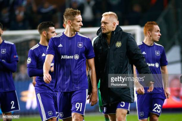 Lukasz Teodorczyk forward of RSC Anderlecht and Olivier Deschacht defender of RSC Anderlecht during the Champions League Group B match between RSC...