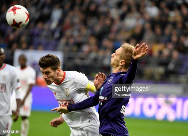 Lukasz Teodorczyk forward of RSC Anderlecht and Sebastien Pocognoli defender of Standard Liege during the Jupiler Pro League match between RSC...