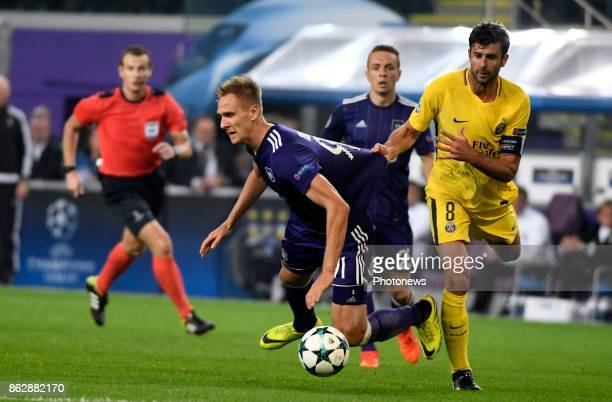 Lukasz Teodorczyk forward of RSC Anderlecht and Thiago Motta midfielder of PSG during the Champions League Group B match between RSC Anderlecht and...