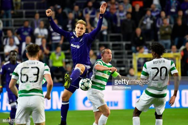 Lukasz Teodorczyk forward of RSC Anderlecht battles for the ball with Scott Brown midfielder of Celtic FC during the Champions League Group B match...