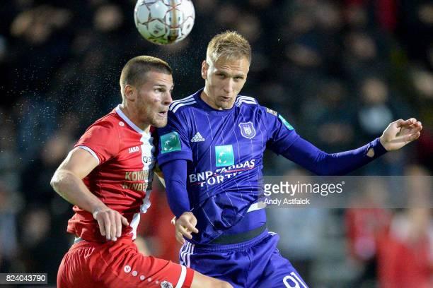 ANTWERP BELGIUM JULY Lukasz Teodorczyk from Anderlecht wins the ball from Alexander Corryn from Antwerp during the Jupiler League match between Royal...
