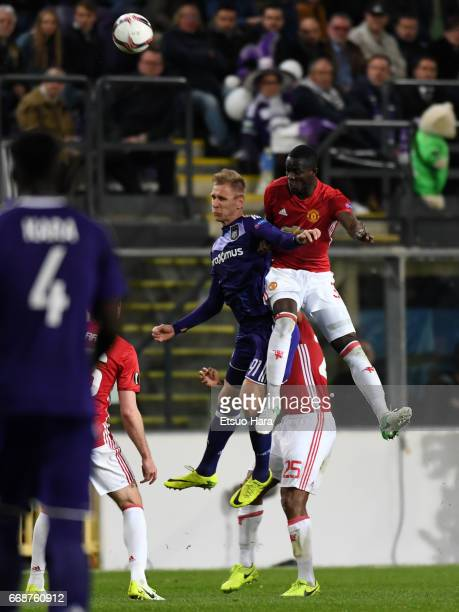 Lukasz Teodorczyk of Anderleht and Eric Bailly of Manchester United compete for the ball during the UEFA Europa League quarter final first leg match...