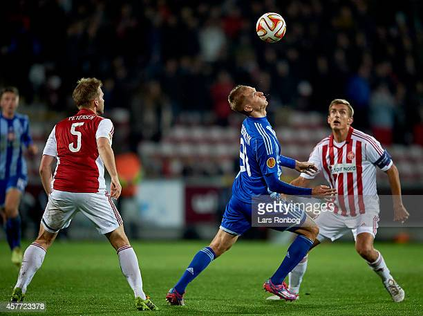 Lukasz Teodorczyk of Dynamo Kyiv and Thomas Augustinussen of AaB Aalborg compete for the ball during the UEFA Europa League match between AaB Aalborg...