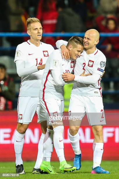 Lukasz Teodorczyk of Poland celebrates with teammates Piotr Zielinski and Michal Pazdan during the FIFA World Cup 2018 qualification football match...