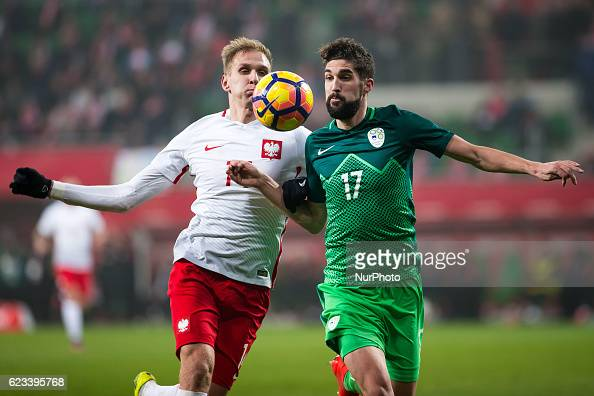 Lukasz Teodorczyk of Poland vies Miha Mevlja of Slovenia during the international friendly football match Poland vs Slovenia on November 14 2016 in...