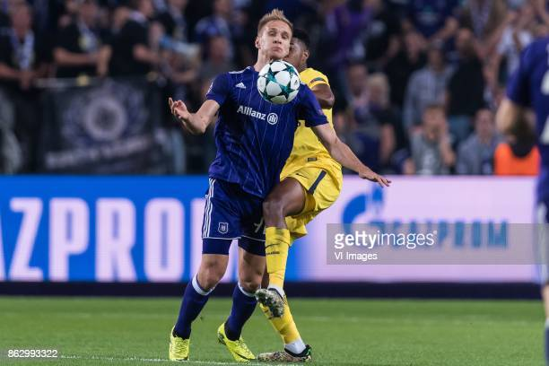 Lukasz Teodorczyk of RSC Anderlecht Presnel Kimpembe of Paris SaintGermain during the UEFA Champions League group B match between RSC Anderlecht and...