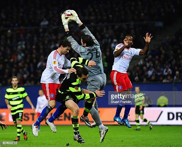 Lukasz Zaluska of Celtic makes a save from Tomas Rincon and Ze Roberto of Hamburg during the UEFA Europa League game between Hamburger Sv and Glasgow...