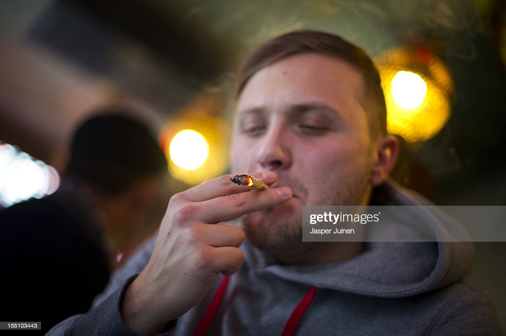 Luke, 28 years old from London, smokes cannabis in a coffee shop on November 1, 2012 in the center of Amsterdam, Netherlands. Coffee shops in the Dutch captial will remain open to tourists after its mayor, Eberhard van der Laan, decided that tourists will not be banned from the 220 coffee shops in Amsterdam where marijuana and hashish are openly sold and consumed. The decision came after the new government of the Netherlands stated that it would be up to local authorities to decide whether or not to impose a ban on cannabis.