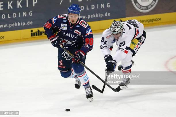 Luke Adam of Mannheim is challenged by Marcel Noebels of Berlin during the DEL Playoffs quarter finals Game 1 between Adler Mannheim and Eisbareren...
