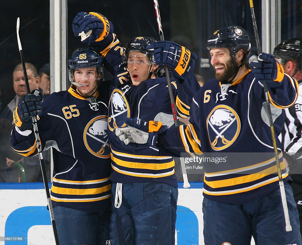 Luke Adam #72 of the Buffalo Sabres celebrates his first-period goal against the Ottawa Senators with teammates Brian Flynn #65 and Mike Weber #6 on April 05, 2013 at the First Niagara Center in Buffalo, New York.