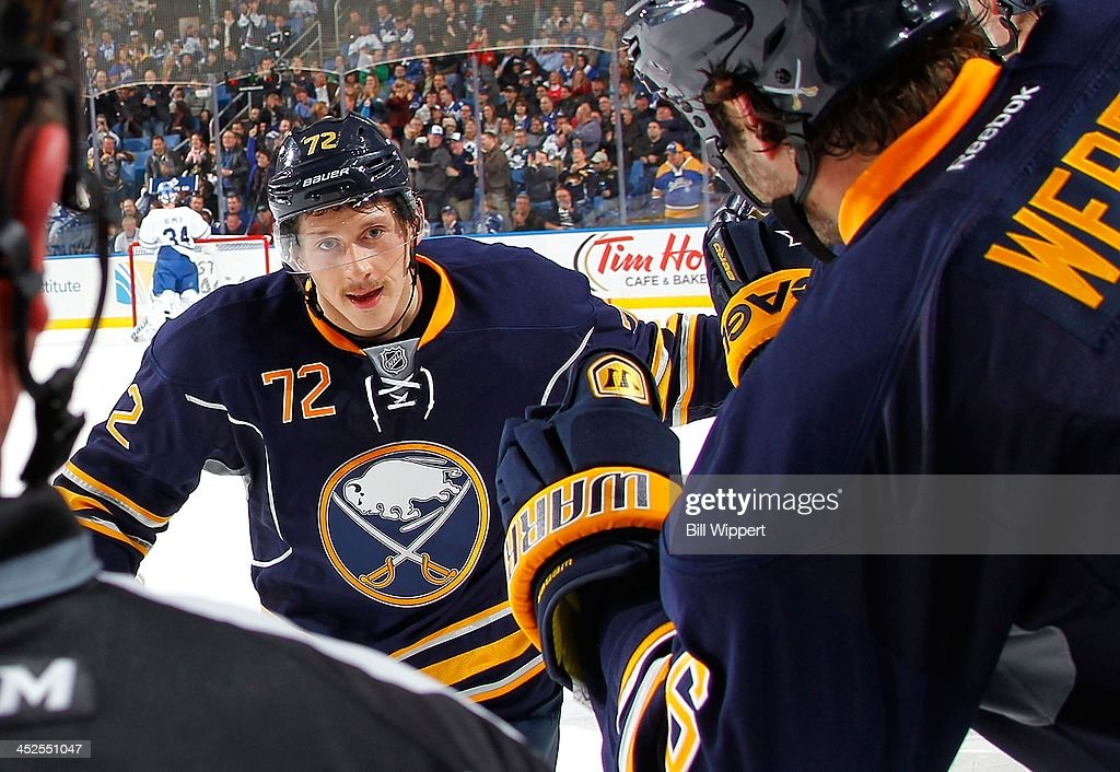 Luke Adam of the Buffalo Sabres celebrates his second period goal against the Toronto Maple Leafs with teammates on November 29 2013 at the First...