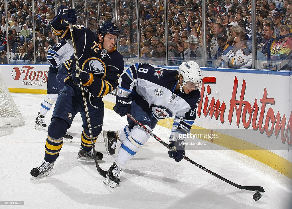 Luke Adam #72 of the Buffalo Sabres defends against <a gi-track='captionPersonalityLinkClicked' href=/galleries/search?phrase=Alexander+Burmistrov&family=editorial&specificpeople=4782297 ng-click='$event.stopPropagation()'>Alexander Burmistrov</a> #8 of the Winnipeg Jets during their NHL game at First Niagara Center November 8, 2011 in Buffalo, New York.