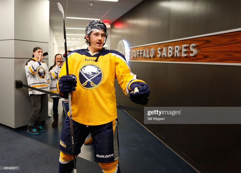 Luke Adam of the Buffalo Sabres prepares to play against the Detroit Red Wings on November 24 2013 at the First Niagara Center in Buffalo New York