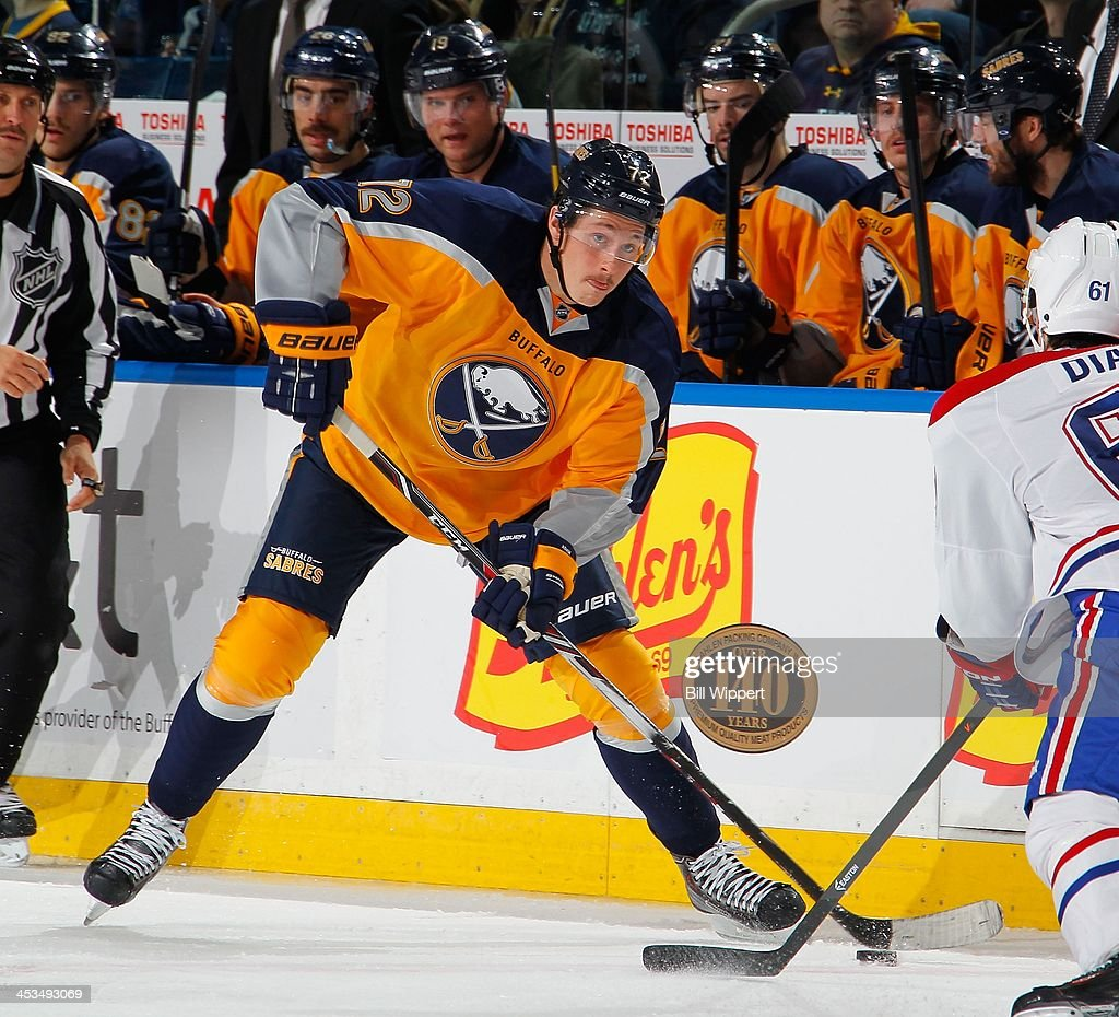 Luke Adam of the Buffalo Sabres skates against the Montreal Canadiens on November 27 2013 at the First Niagara Center in Buffalo New York
