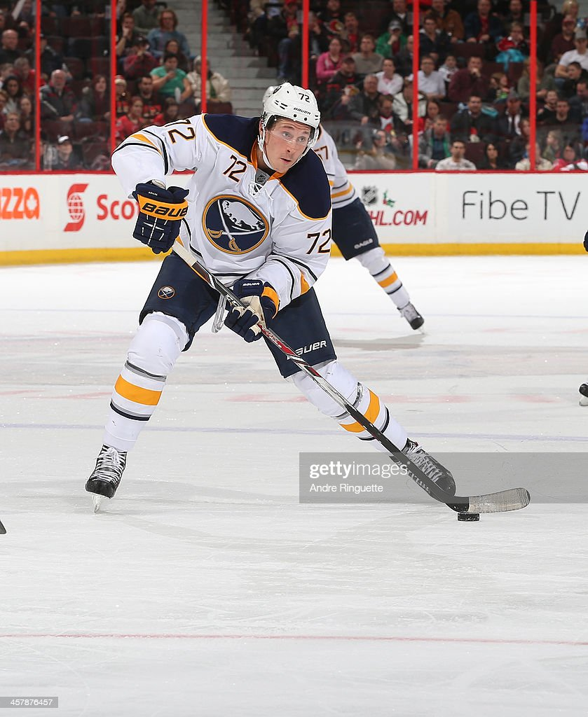 Luke Adam of the Buffalo Sabres skates against the Ottawa Senators at Canadian Tire Centre on December 12 2013 in Ottawa Ontario Canada