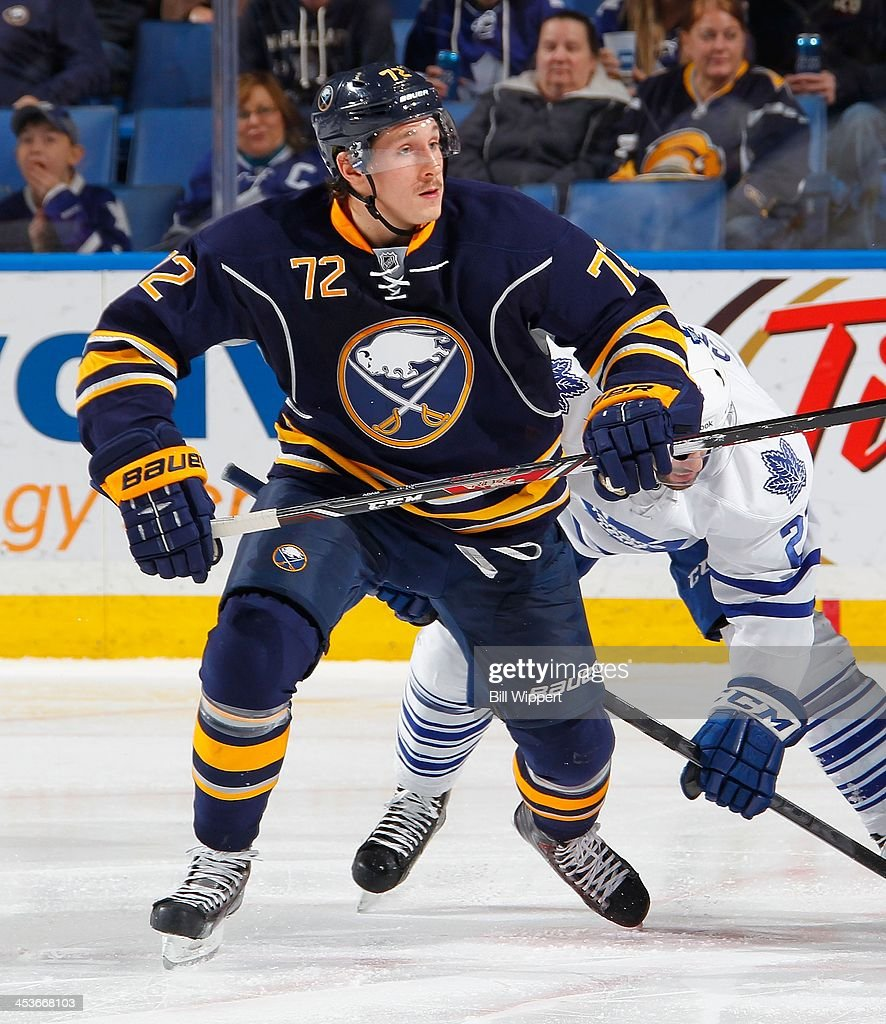 Luke Adam of the Buffalo Sabres skates against the Toronto Maple Leafs on November 29 2013 at the First Niagara Center in Buffalo New York