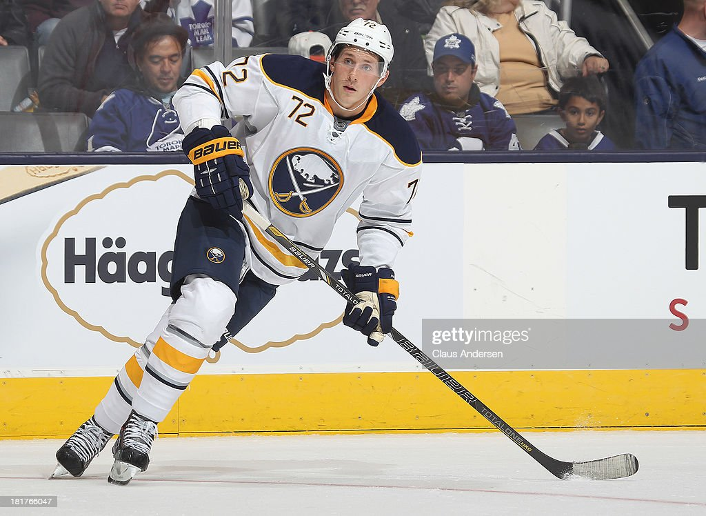 Luke Adam of the Buffalo Sabres skates in a preseason game against the Toronto Maple Leafs on Sept 22 2013 at the Air Canada Centre in Toronto...