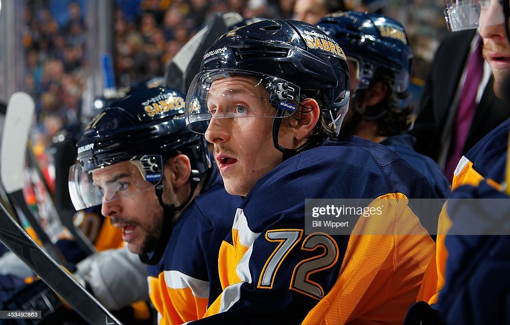 Luke Adam of the Buffalo Sabres watches the action against the Detroit Red Wings on November 24 2013 at the First Niagara Center in Buffalo New York