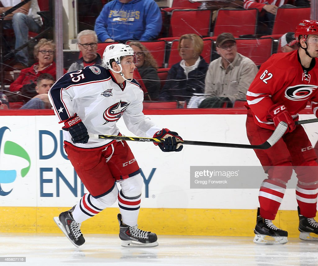 Luke Adam of the Columbus Blue Jackets skates for position during an NHL game against the Carolina Hurricanes at PNC Arena on March 10 2015 in...