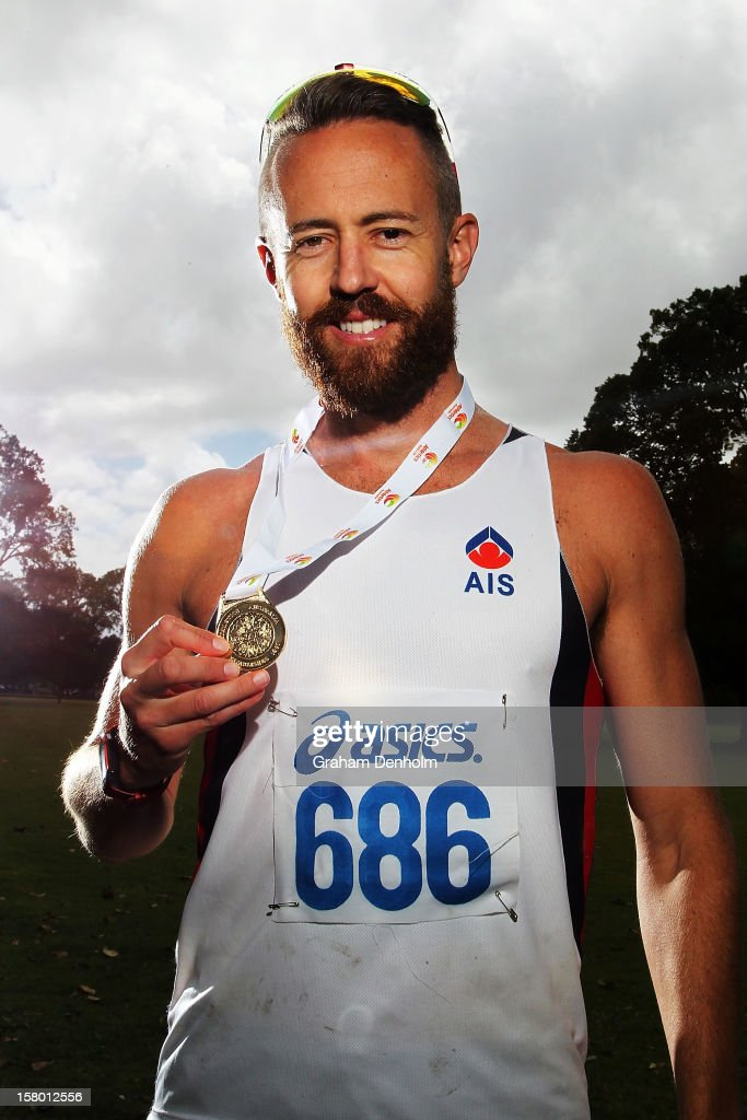 Luke Adams of New South Wales poses with his gold medal after victory in the Mens 50000 metre Race Walk Championship Open during the 50km race walking championships at Lakeside Stadium on December 9, 2012 in Melbourne, Australia.