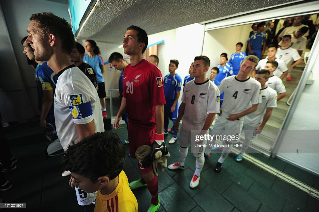 <a gi-track='captionPersonalityLinkClicked' href=/galleries/search?phrase=Luke+Adams&family=editorial&specificpeople=200711 ng-click='$event.stopPropagation()'>Luke Adams</a> of New Zealand leads out his team during the FIFA U-20 World Cup Group F match between New Zealand and Uzbekistan at the Ataturk Stadium on June 23, 2013 in Bursa, Turkey.
