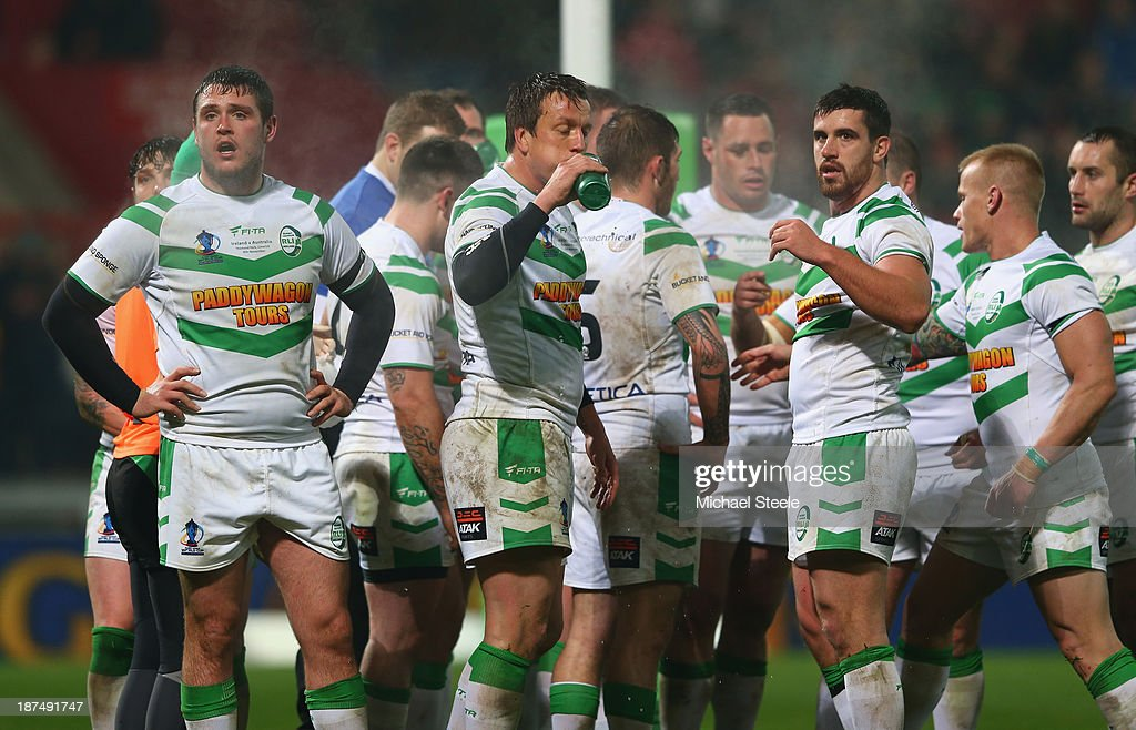 Luke Ambler (L) of Ireland looks on alongside team mates after conceding another try in their 0-50 defeat during the Rugby League World Cup Group A match between Australia and Ireland at Thomond Park on November 9, 2013 in Limerick, .