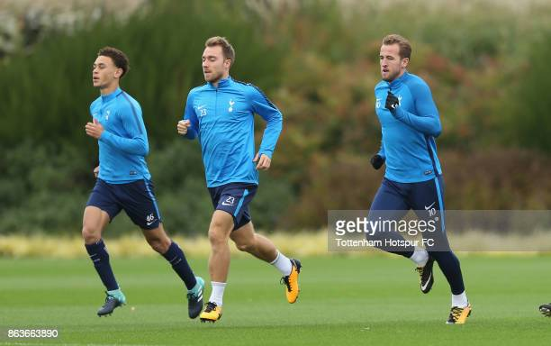 Luke Amos Christian Eriksen and Harry Kane of Tottenham during the Tottenham Hotspur training session at Tottenham Hotspur Training Centre on October...