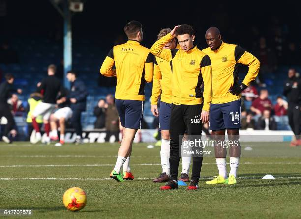 Luke Amos of Southend United looks on with team mate MarcAntoine Fortune during the pre match warm up prior to the Sky Bet League One match between...