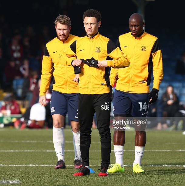 Luke Amos of Southend United looks on with team mates MarcAntoine Fortune and Adam Thompson during the pre match warm up prior to the Sky Bet League...