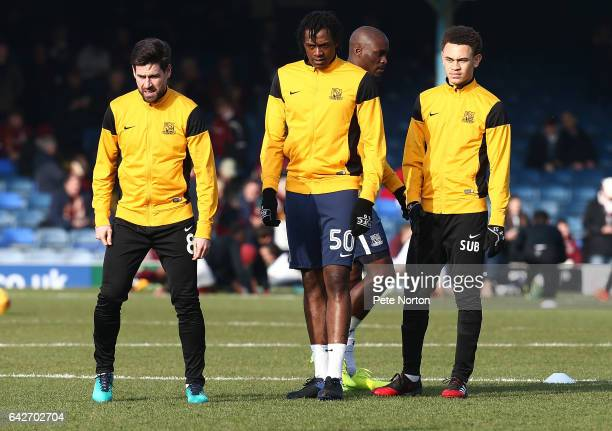 Luke Amos of Southend United looks on with team mates Michael Timlin and Nile Ranger during the pre match warm up prior to the Sky Bet League One...
