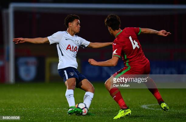 Luke Amos of Tottenham Hotspur holds off Jack Evans of Swansea City during the Premier League 2 match between Tottenham Hotspur and Swansea City at...