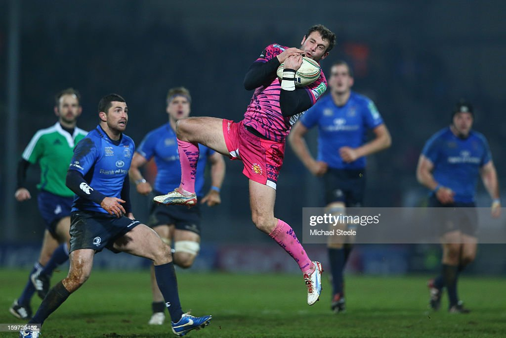 <a gi-track='captionPersonalityLinkClicked' href=/galleries/search?phrase=Luke+Arscott&family=editorial&specificpeople=2350778 ng-click='$event.stopPropagation()'>Luke Arscott</a> (R)of Exeter Chiefs catches a high ball as Rob Kearney (L) of Leinsterlooks on during the Heineken Cup Pool Five match between Exeter Chiefs and Leinster at Sandy Park on January 19, 2013 in Exeter, England.