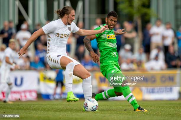 Luke Ayling of Leeds Unitde and Kwame Yeboah of Borussia Moenchengladbach controls the ball during a friendly match between Borussia Moenchengladbach...