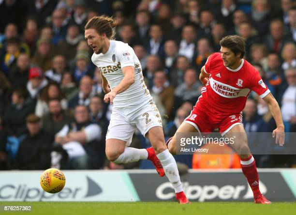 Luke Ayling of Leeds United beats George Friend of Middlesbrough during the Sky Bet Championship match between Leeds United and Middlesbrough at...