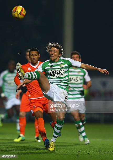 Luke Ayling of Yeovil Town clears from Tom Ince of Blackpool during the Sky Bet Championship match between Yeovil Town and Blackpool at Huish Park on...