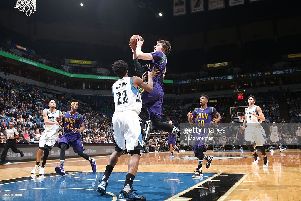 Luke Babbitt #8 of the New Orleans Pelicans goes for the lay up against Andrew Wiggins #22 of the Minnesota Timberwolves during the game on February 8, 2016 at Target Center in Minneapolis, Minnesota.