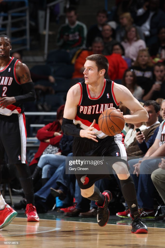 <a gi-track='captionPersonalityLinkClicked' href=/galleries/search?phrase=Luke+Babbitt&family=editorial&specificpeople=5122155 ng-click='$event.stopPropagation()'>Luke Babbitt</a> #8 of the Portland Trail Blazers dribbles the ball while looking to pass against the Milwaukee Bucks on March 19, 2013 at the BMO Harris Bradley Center in Milwaukee, Wisconsin.